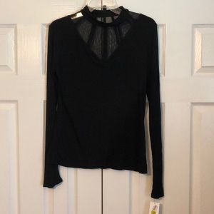 Long sleeve black top with flirty neck detail